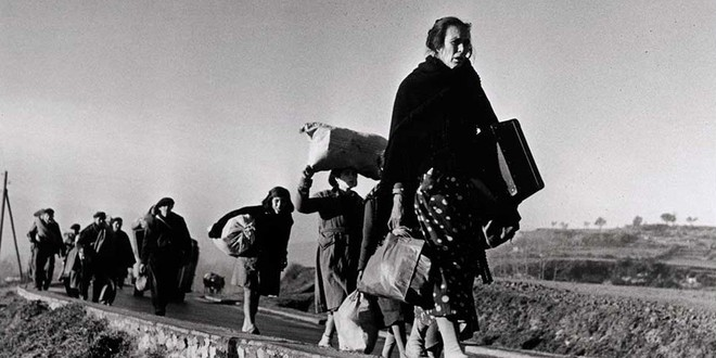 Catalans make the exile from Catalunya to France in 1939, captured by iconic photographer, Robert Capa.