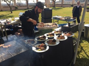 one of the chefs of Coquo Catering prepares the special meal.